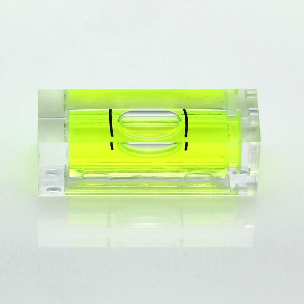 SC29 – Plastic sq. section vial, 29x10x10mm, green liquid